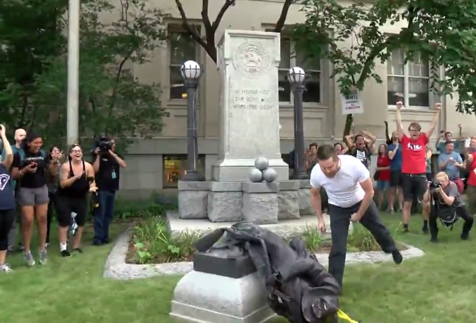 The spitting on and kicking of the fallen Confederate statue by modern American slaves