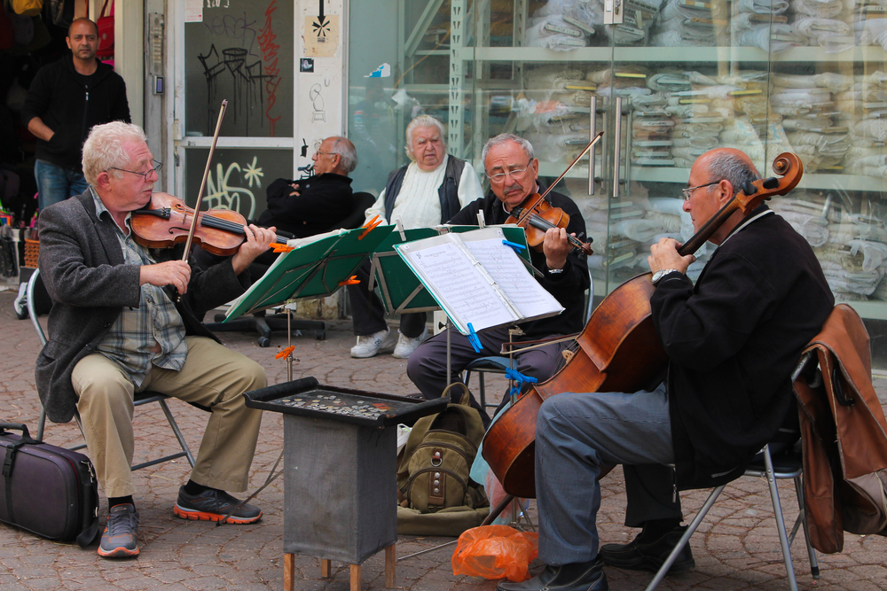 Any city with old men playing string instruments must be safe