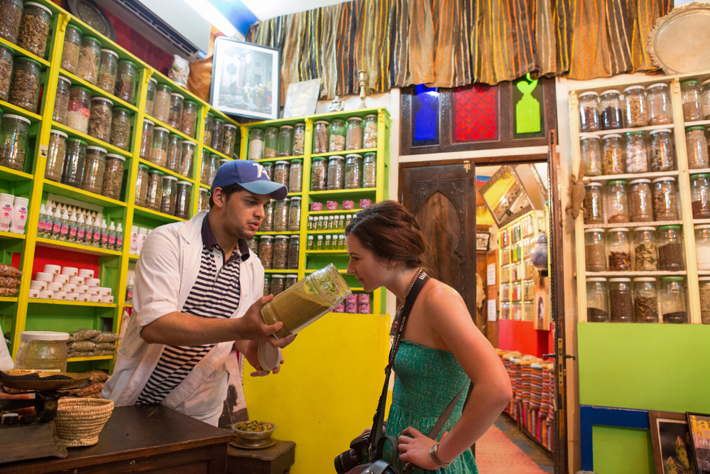 Sniffing up a storm in a spice store in the Marrakech Souk