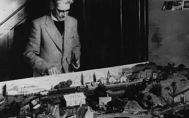 Thomas the Tank Engine creator Rev W Awdry, an unabashed trainspotter, with his model railway