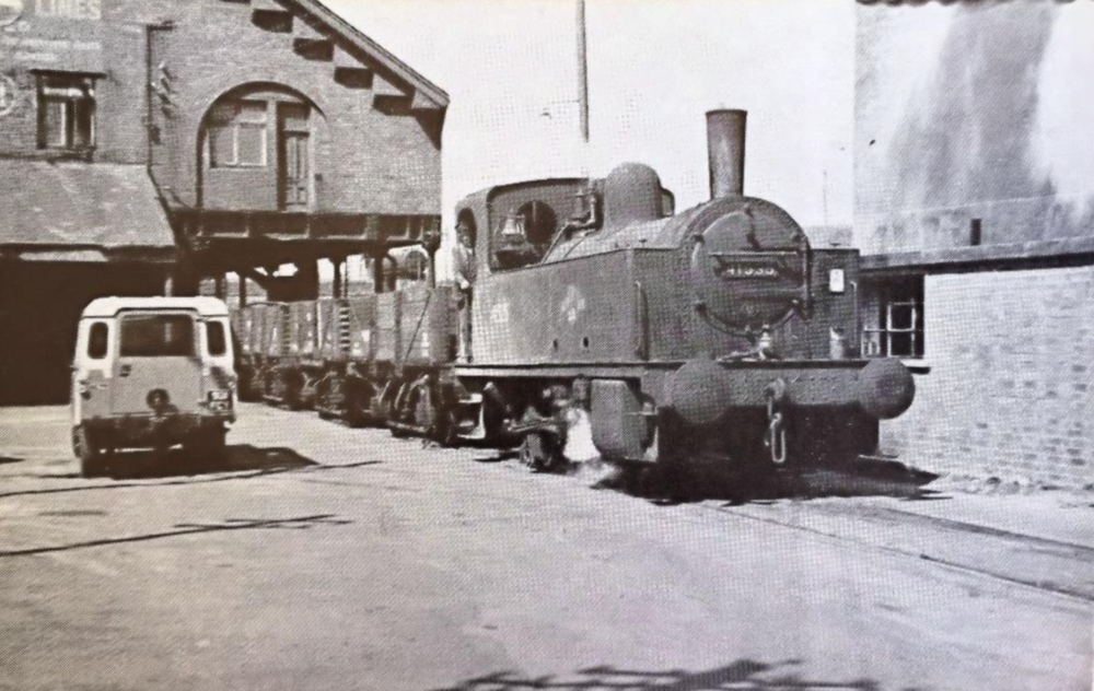 Ex-Midland Railway 0-4-0 Saddle Tank outside the old Coast Lines warehouse on South Dock, May 1964.   Photograph [from a postcard] by B.Owen / Railway Club of Wales and used with many thanks. The warehouse is, of course, now incorporated into the National Waterfront Museum.