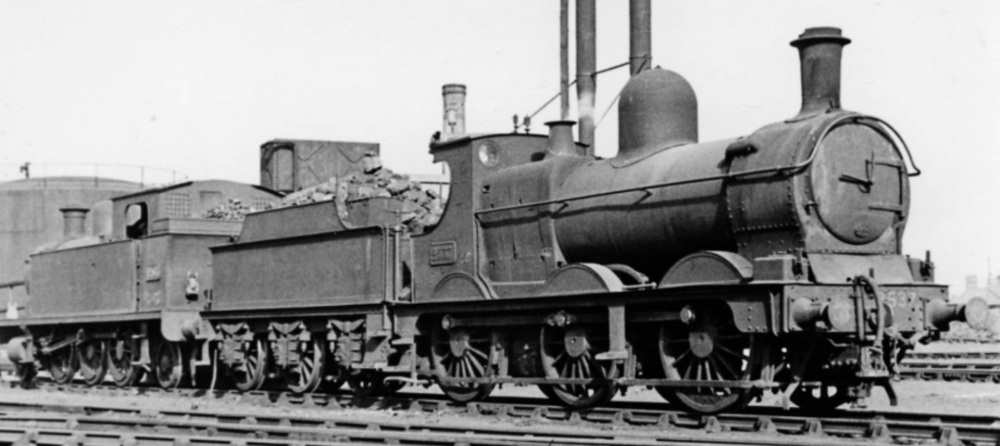 Who doesn't love a Dean Goods? A view of Cardiff Canton on 15th April 1951 with two pre-grouping locos in the yard. Nearest the camera is Dean Goods 0-6-0 No. 2537 and behind is Alexandra Docks Railway 2-6-2T No. 1205, which was used as shed pilot until it was withdrawn in 1955.  Photo: Ben Brooksbank Creative Commons Attribution