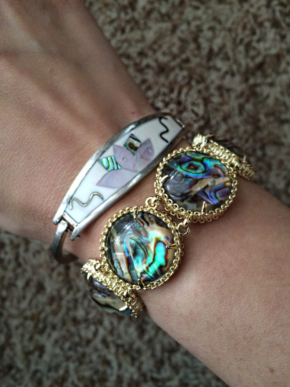 Here I mixed a silver bracelet my dad bought for me in Mexico when I was 10, with a new gold Kendra Scott piece (similar  here ). The Abalone shell in both pulls the look together.