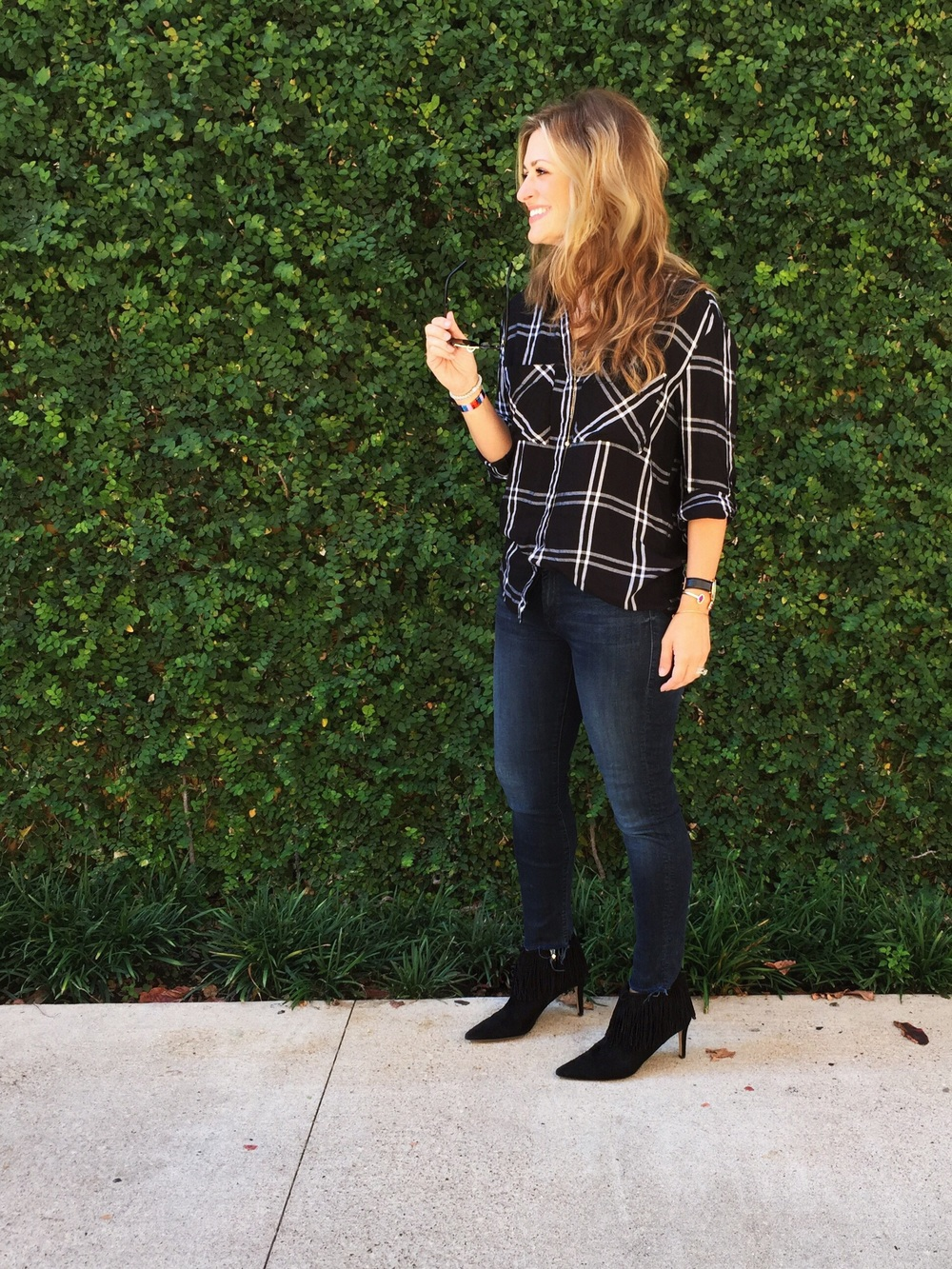 Trying out some Fall trends here with a plaid & fringe combo. Top:  Express  Jeans:  Mother  Boots:  Sam Edelman  (and ON SALE!)