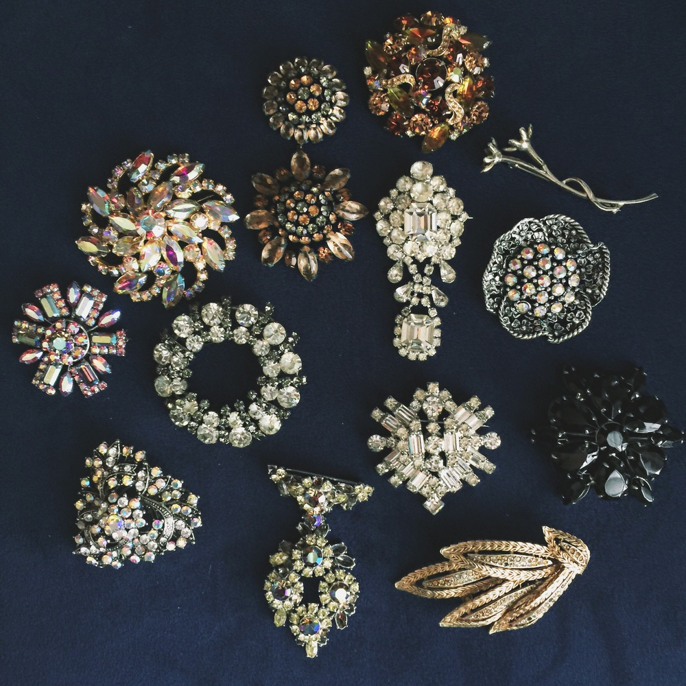 Her collection of brooches came from her grandmother but she has added to it over the years with more amazing thrift store finds. They are GORGEOUS!