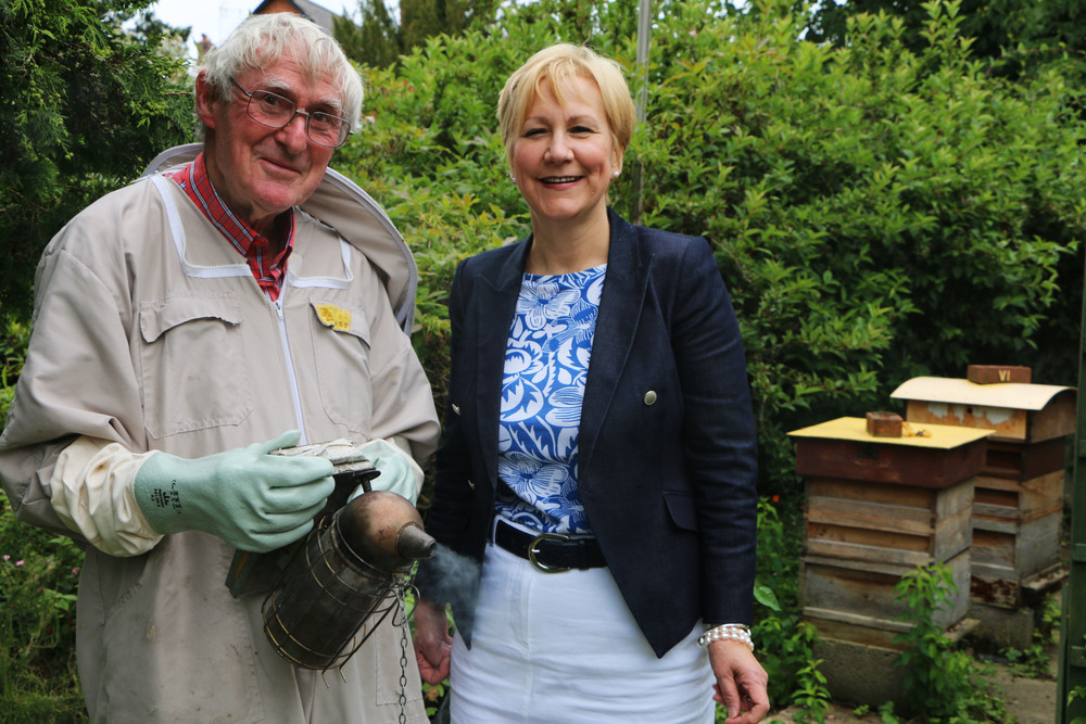 Beekeeper John Gale with Ann Tonks, director of Opus at Cornwall Street