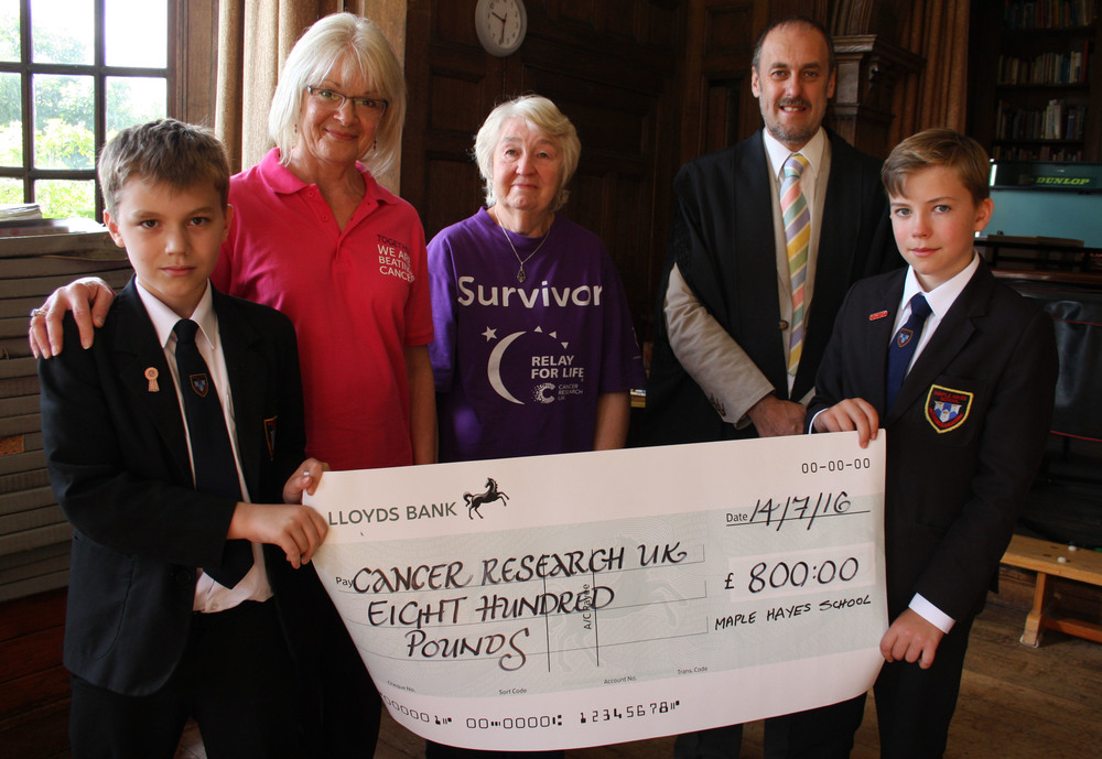 Pupil Daniel Streeter, aged 11, Lorraine Moore and Pauline Colingswood from Tamwroth and Lichfield Research UK group, Dr Daryl Brown, headteacher and pupil Jake Flood, aged 12