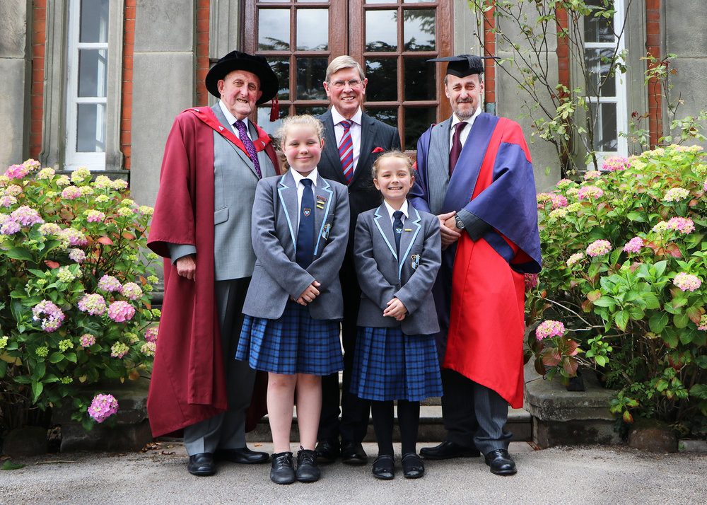 Pupils Katie-Rose Bridgeman (left) and Heidi Fletcher pictured with Mr Ian Dudson, the Lord Lieutenant of Staffordshire (centre), Dr Neville Brown (left) and Dr Daryl Brown (right)