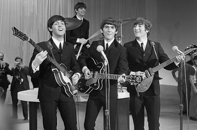 the-beatles-ed-sullivan-smiling-1964-billboard-650.jpg