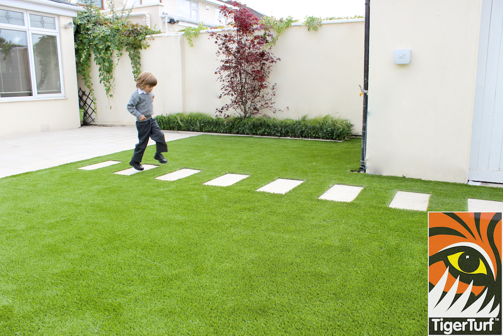 children playing on synthetic grass