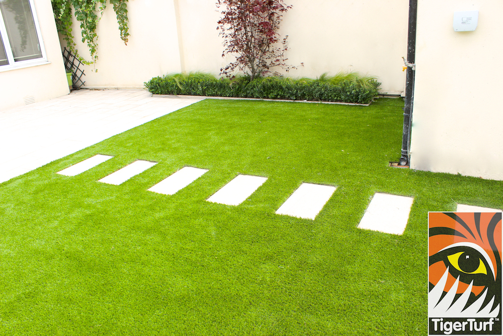 stepping stones on artificial grass lawn