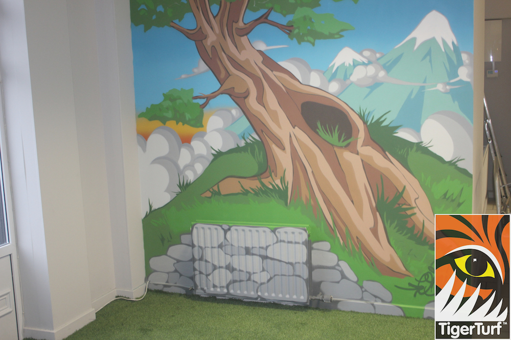 tree mural with grass carpet