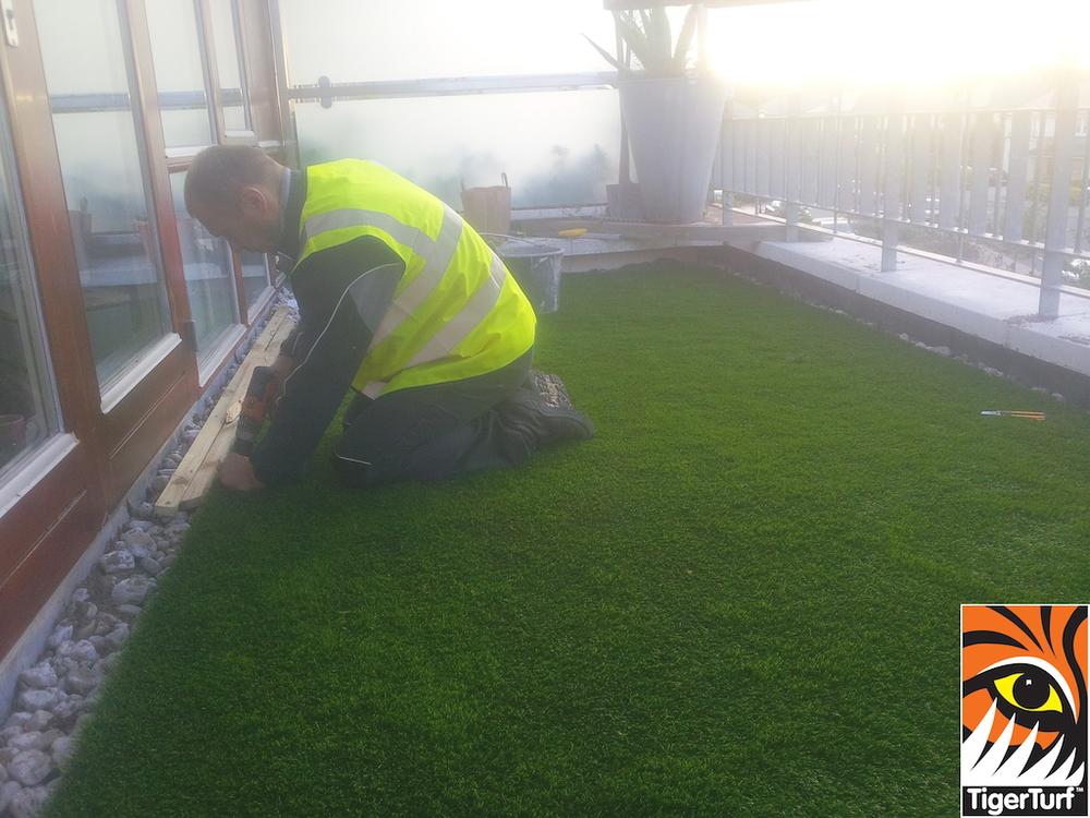 Installer fixing grass