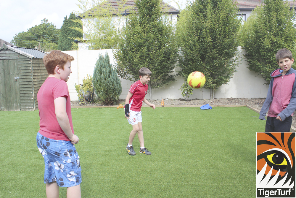 teenagers playing football in garden