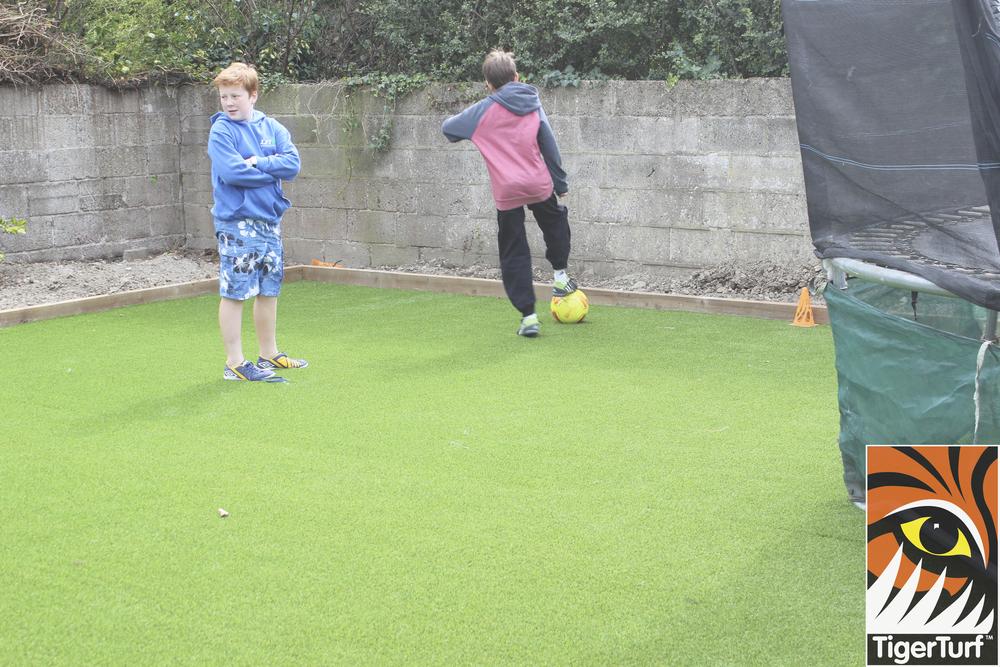 kids playing ball on new turf