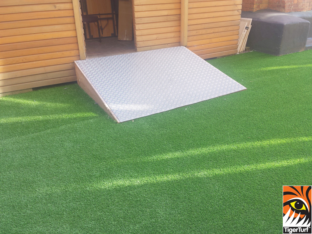 maintenance access with durable TigerTurf synthetic grass