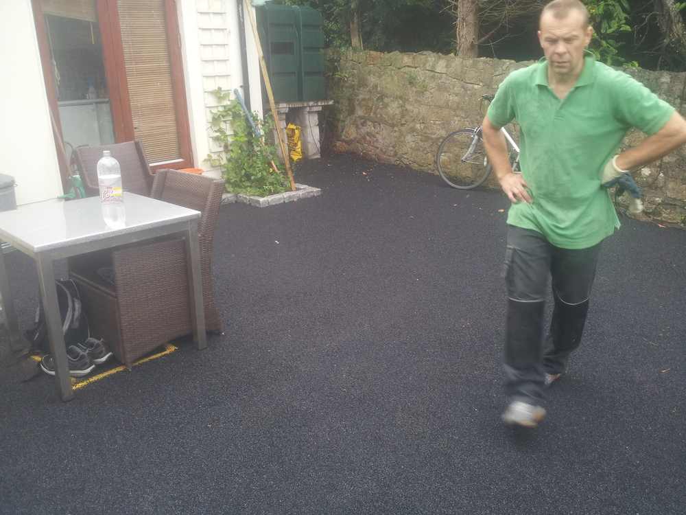 installer inspecting shock pad