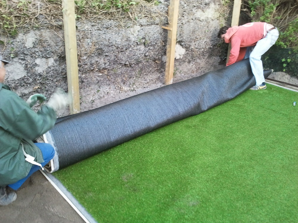 Installers fitting grass turf