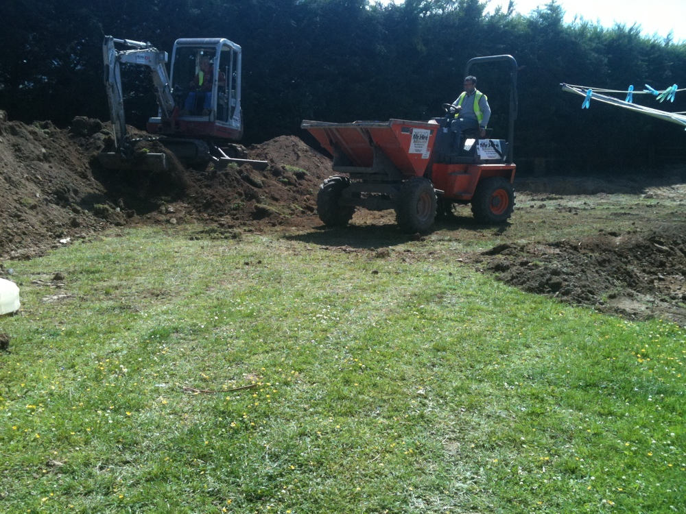 Digger and dumper doing groundwork for Turf installation