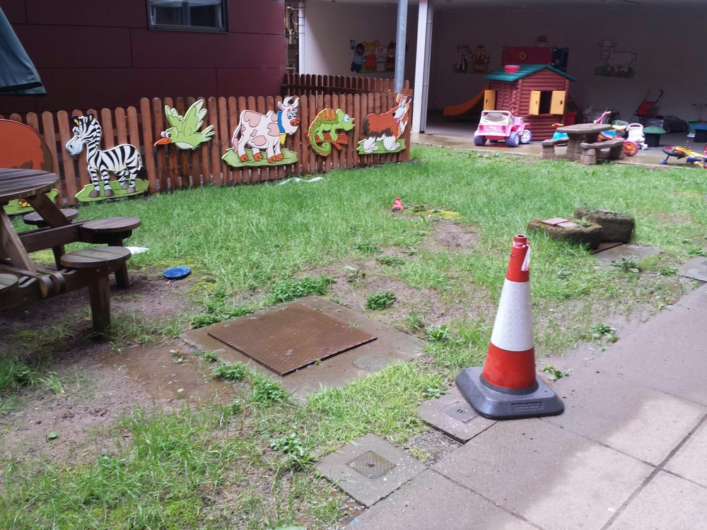 play area before TigerTurf artificial grass