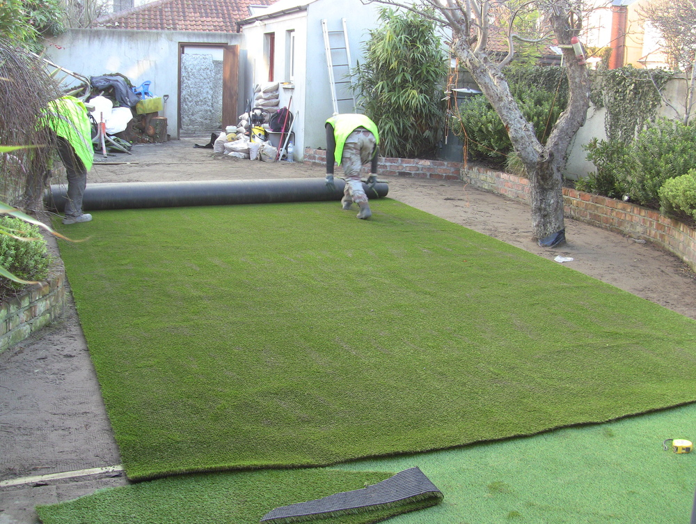 installers rolling out new lawn