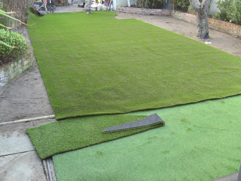 new artificial lawn being fitted