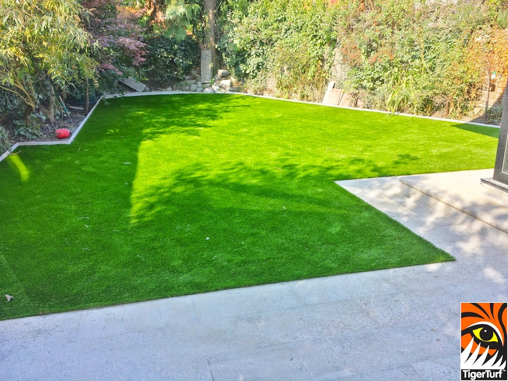 TigerTurf lawn turf and granite patio