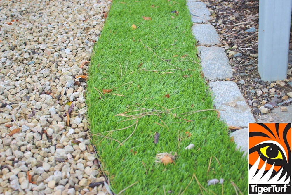 curved synthetic grass lawn in driveway