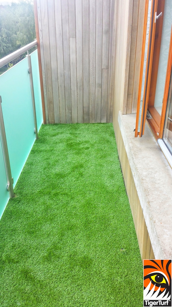 narrow balcony with synthetic grass
