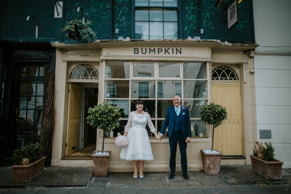 Jenny & Keith standing outside of 119 Sydney street, Kensington, London - BUMPKIN BRASSERIE