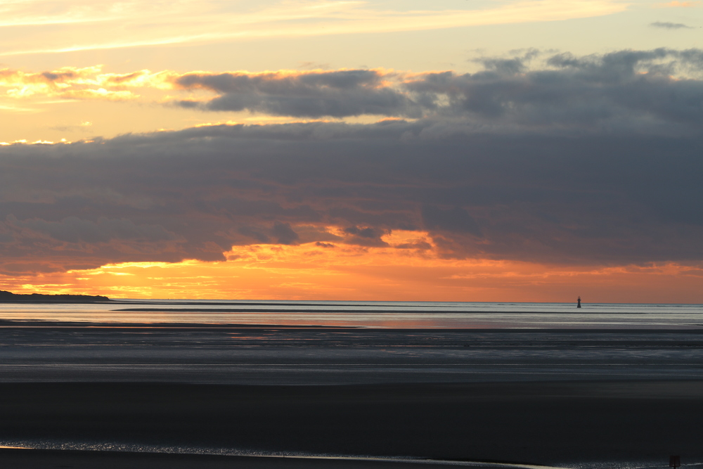 Whiteford Point Lighthouse: viewed at sunset from Llanelli beach.
