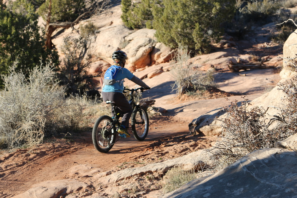 Moab: Dylan mountain biking on single track.