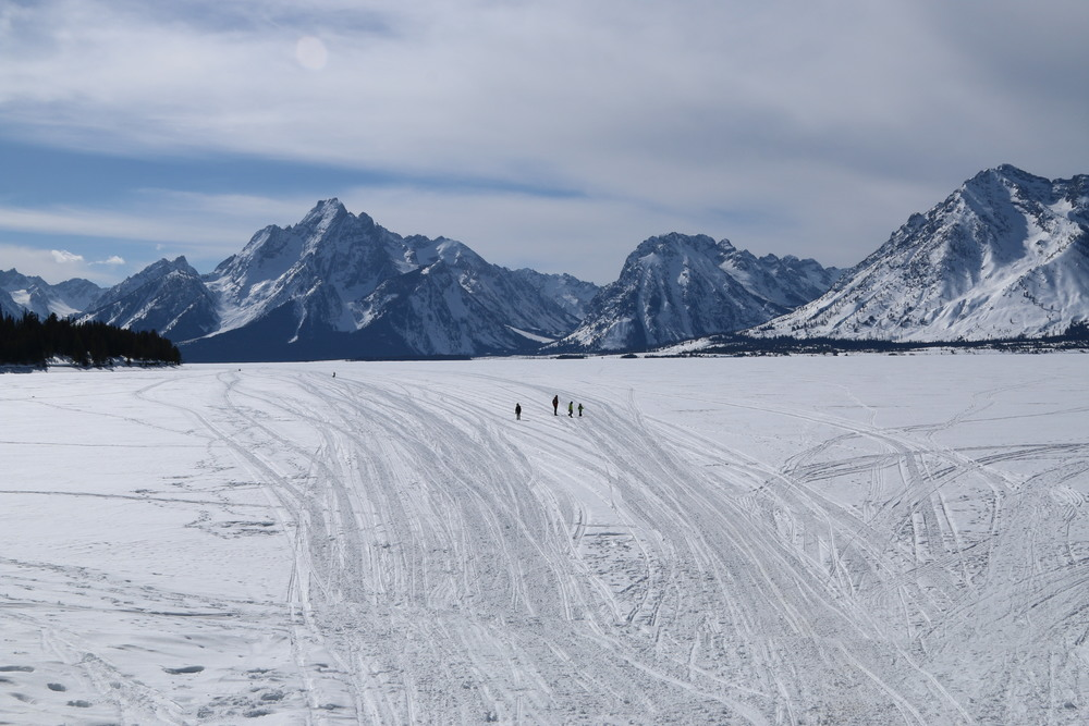 The Davies family walking out onto the frozen Jackson Lake