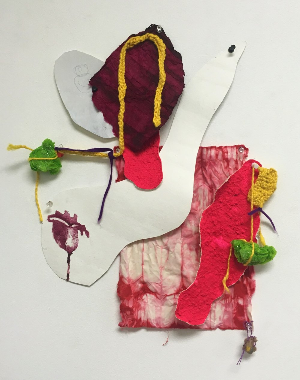 Palms (Together)- 2016  Paper, fabric, acrylic paint, glitter, crayon pieces, yarn and pins.