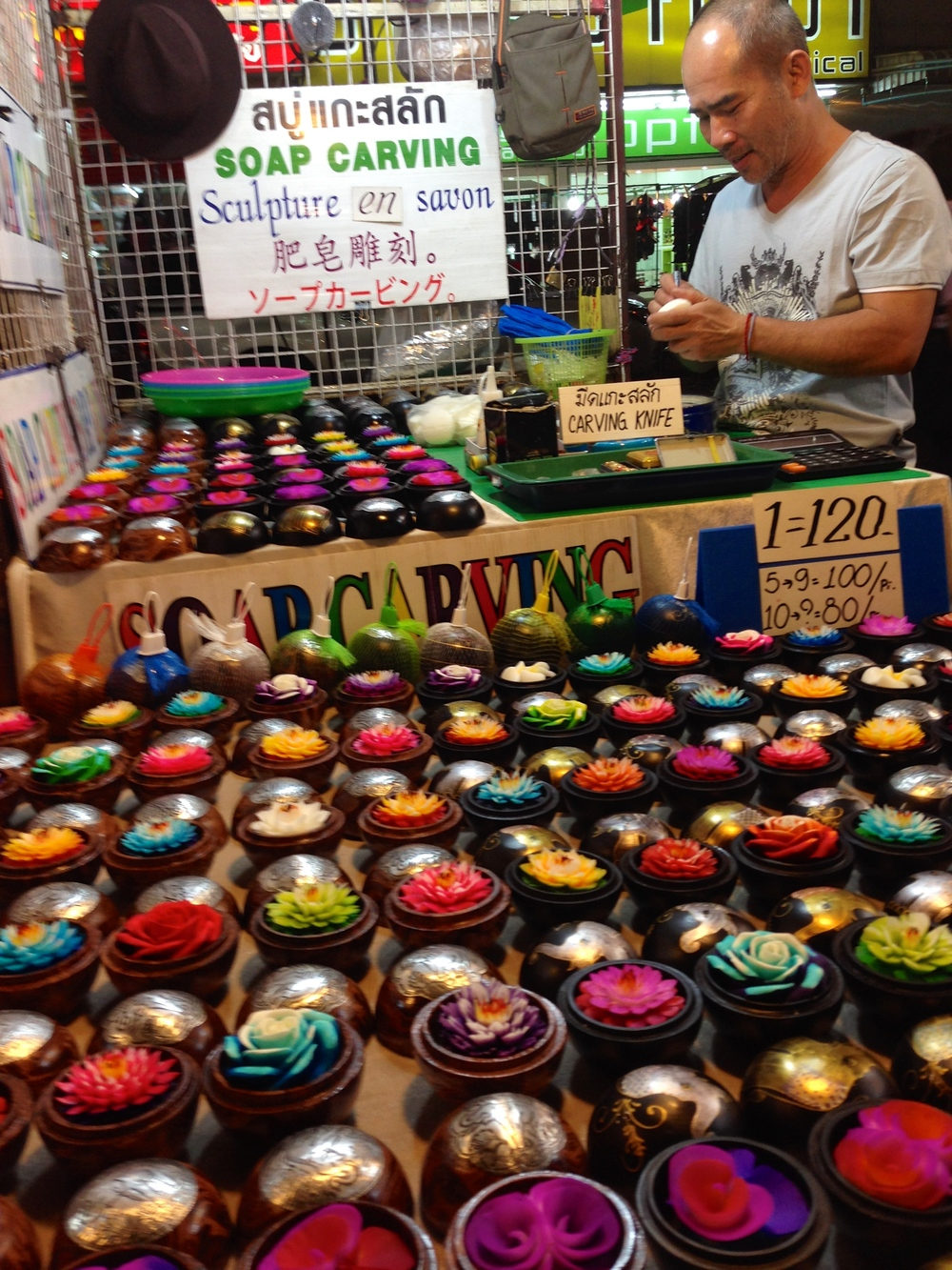Candles carved in the shape of flowers are a popular souvenir