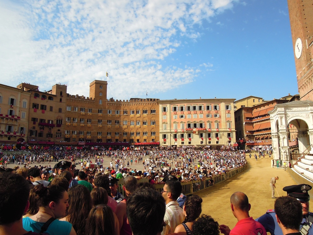 Crowds gather, the volume rises and emotions run high, as the city's riders line up for the start of Il Palio.