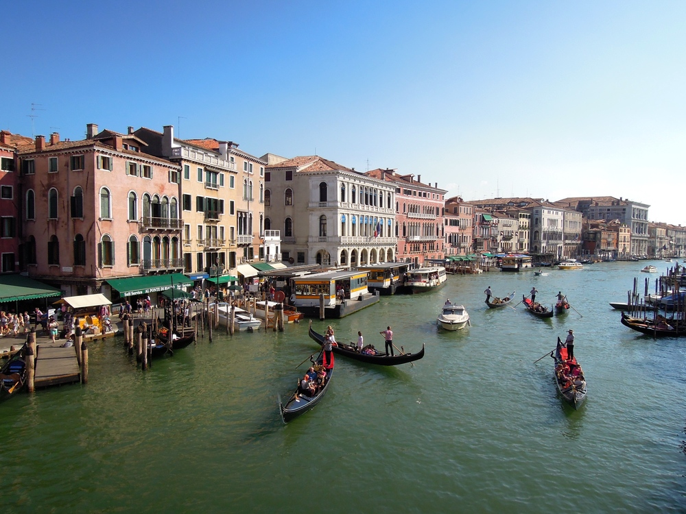 The renowned pastel-hued buildings and gondola-filled waterways of Venice attract tens of thousands of tourists each year.