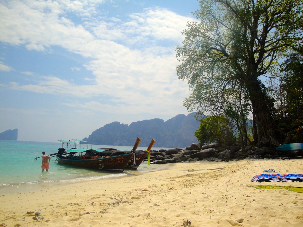 Traditional long boats - the main means of transport between Ko Phi Phi and neighbouring islands - pulled up on the shore.