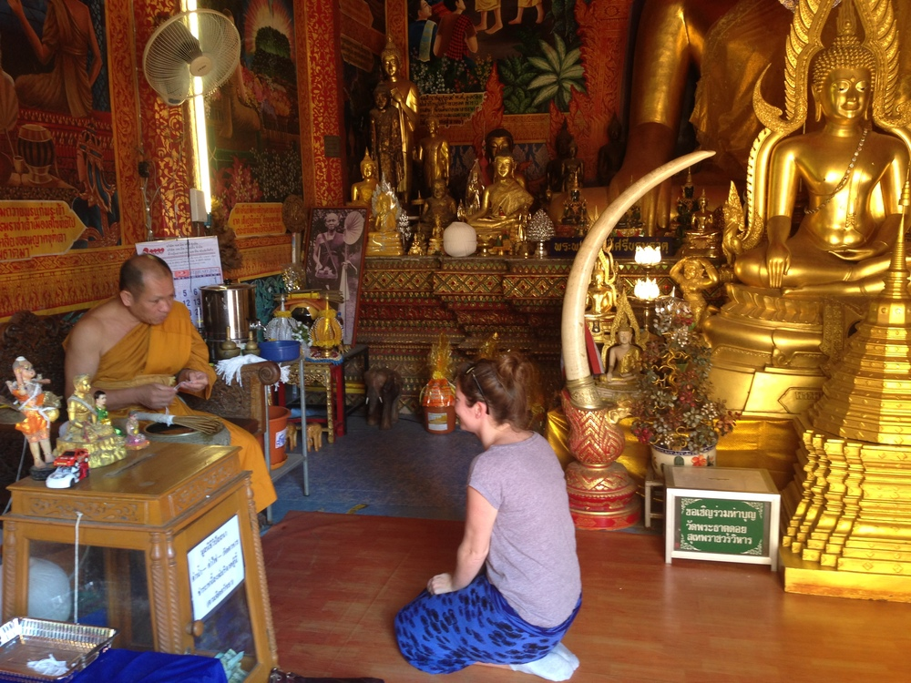 Receiving a blessing at Wat Phra That Doi Suthep - also known as 'the temple on the hill' - a Theravada Buddhist temple.