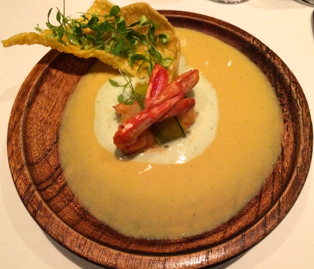 Grilled shrimp on corn soup, with yoghurt, guacamole and a crunchy corn crisp