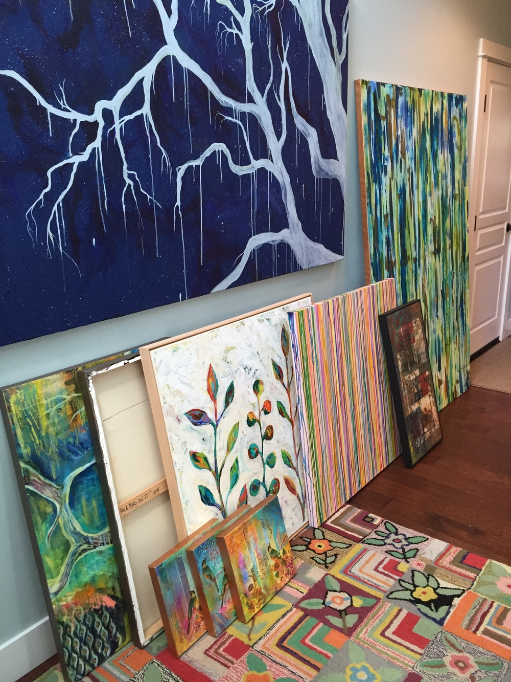 My paintings all lined up in our front hallway and ready to go over the Tour Home.