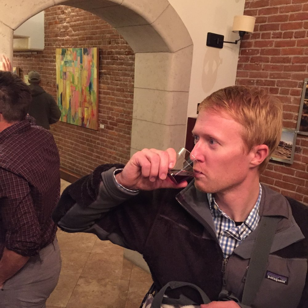 Our friend Caleb, sampling the wine!