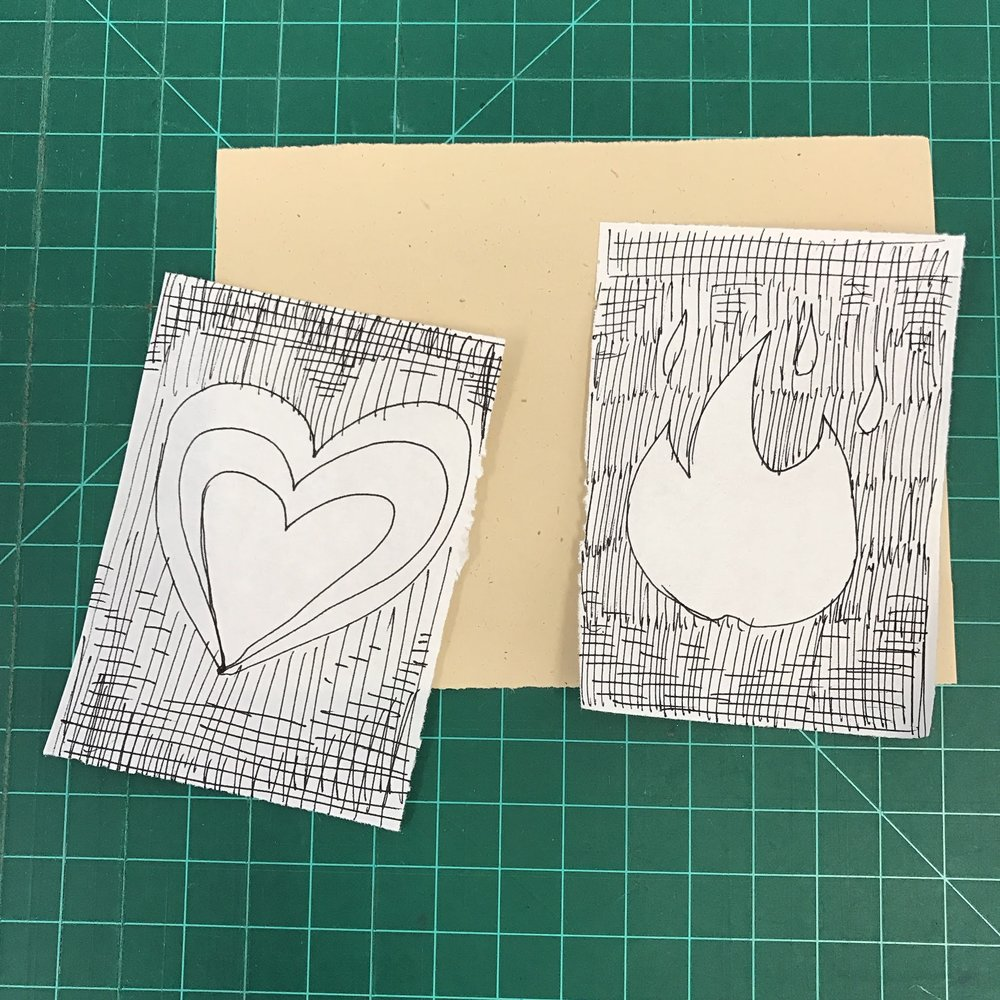 Emoji thumbnails, paper, and self-healing cutting mat.