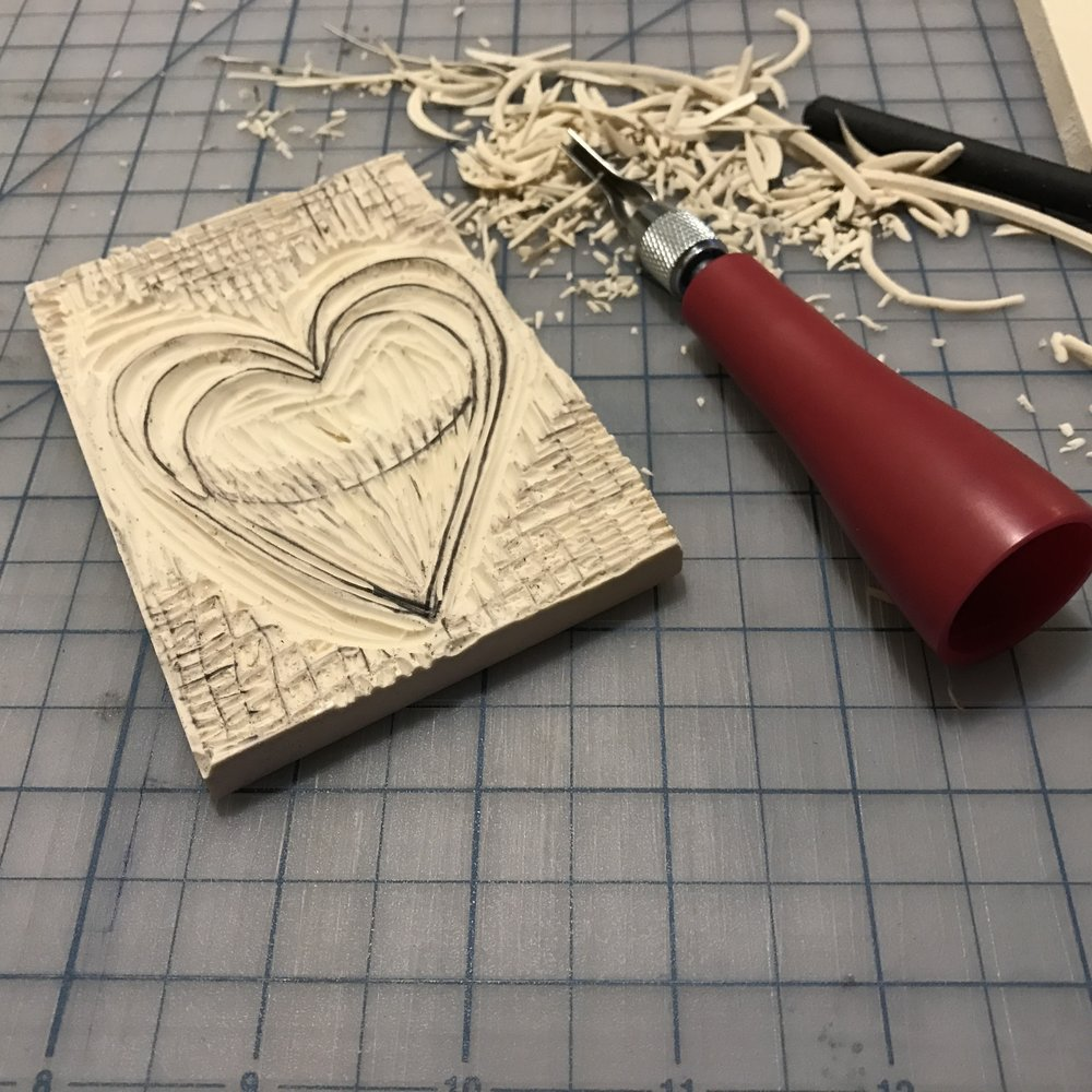 Carving linoleum with speedball linoleum cutter