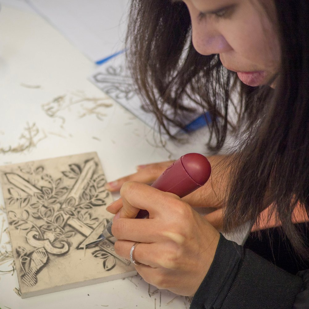 Craft - Cat draws her image onto a linoleum block and begins the process of carving