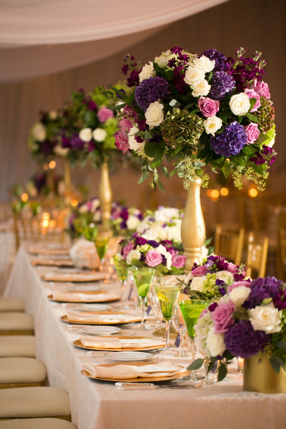 The head-table was TO-DIE-FOR!  A mix of high and low with the bridesmaids bouquets added in to make a luxurious and flower-rich look.