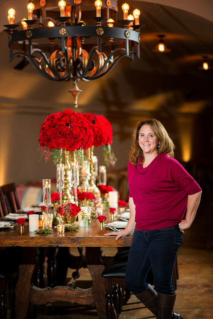 Owner and Director of Blooms at J. Morris Flowers designed this crimson inspired table.