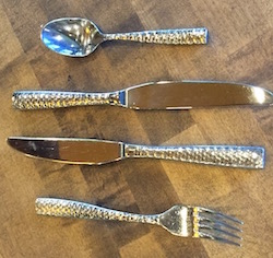 Gold and silver cutlery adds visual interest.