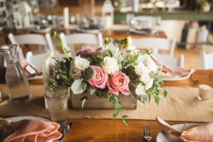Wooden boxes, lanterns with flowers bundles and accent pieces served the long, farm tables well. Photography by Carly Romeo.