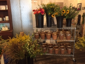 Vases painted in either silver or gold and long, local grown stems.